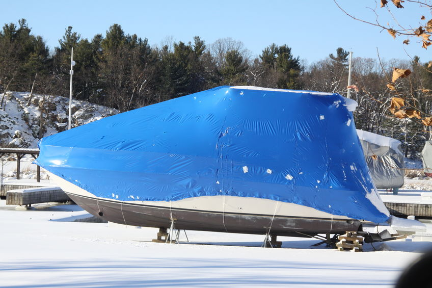 Shrink wrapping or tarps? Two options for winter boat storage.