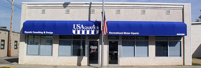 commercial building with a blue canvas awning
